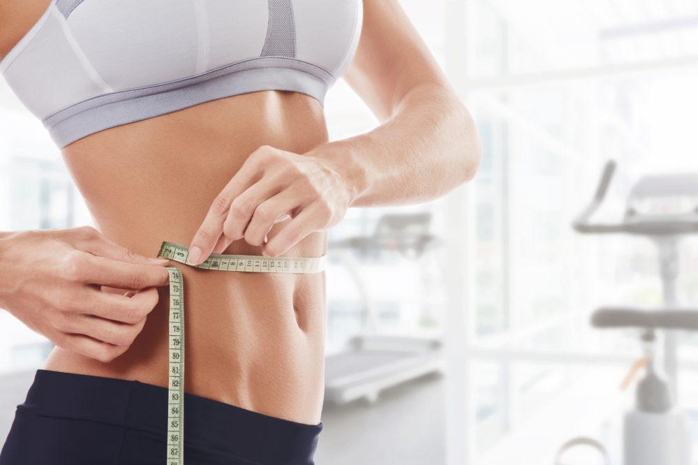 Atleta midiendo su cuerpo