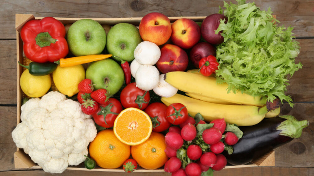 ¿Cuántas porciones de vegetales debe comer por día?